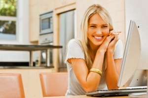 woman-smiling-on-computer-at-home